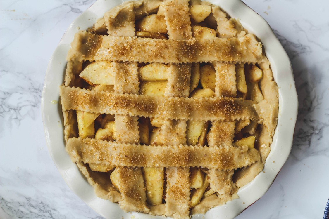 overhead image of lattice stripped pie on a marbled background