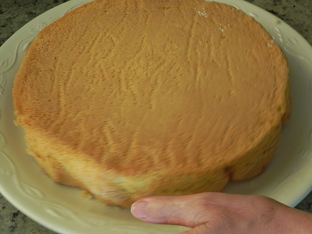 overhead image of a cake on a plate
