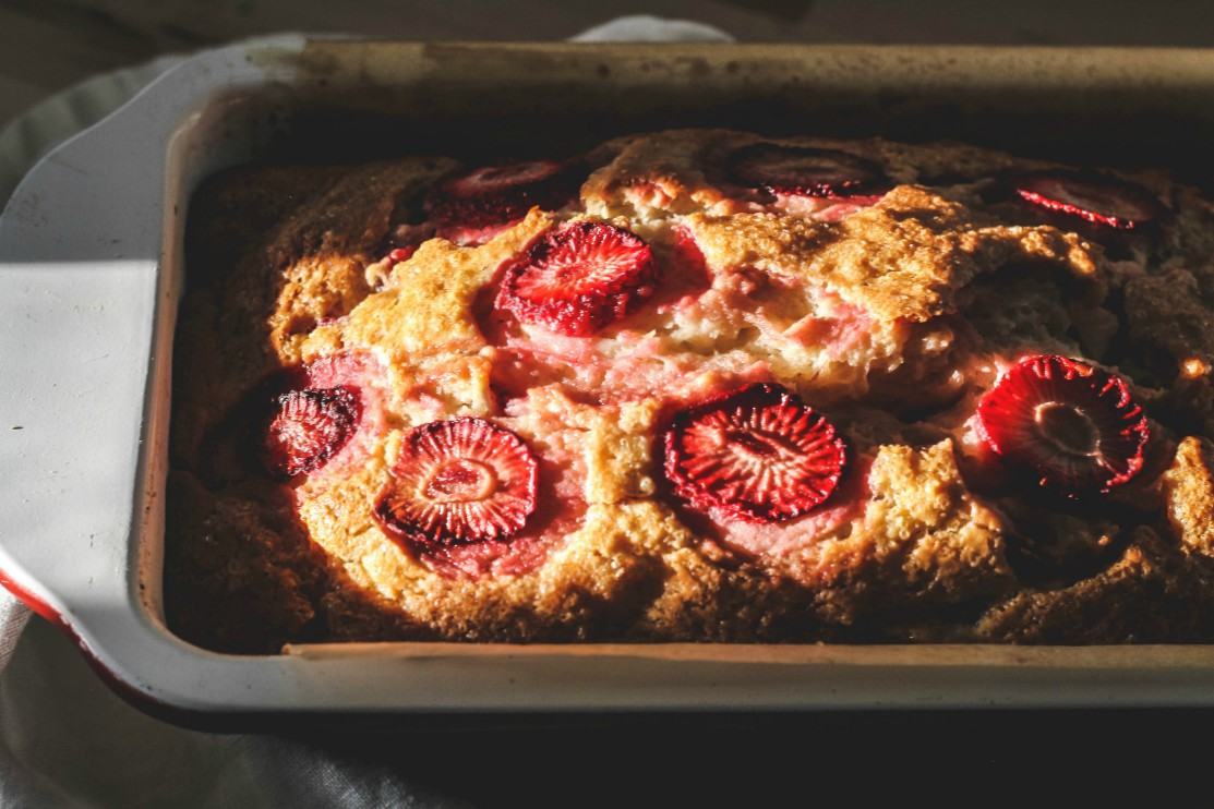 overhead image of bread with strawberries on top