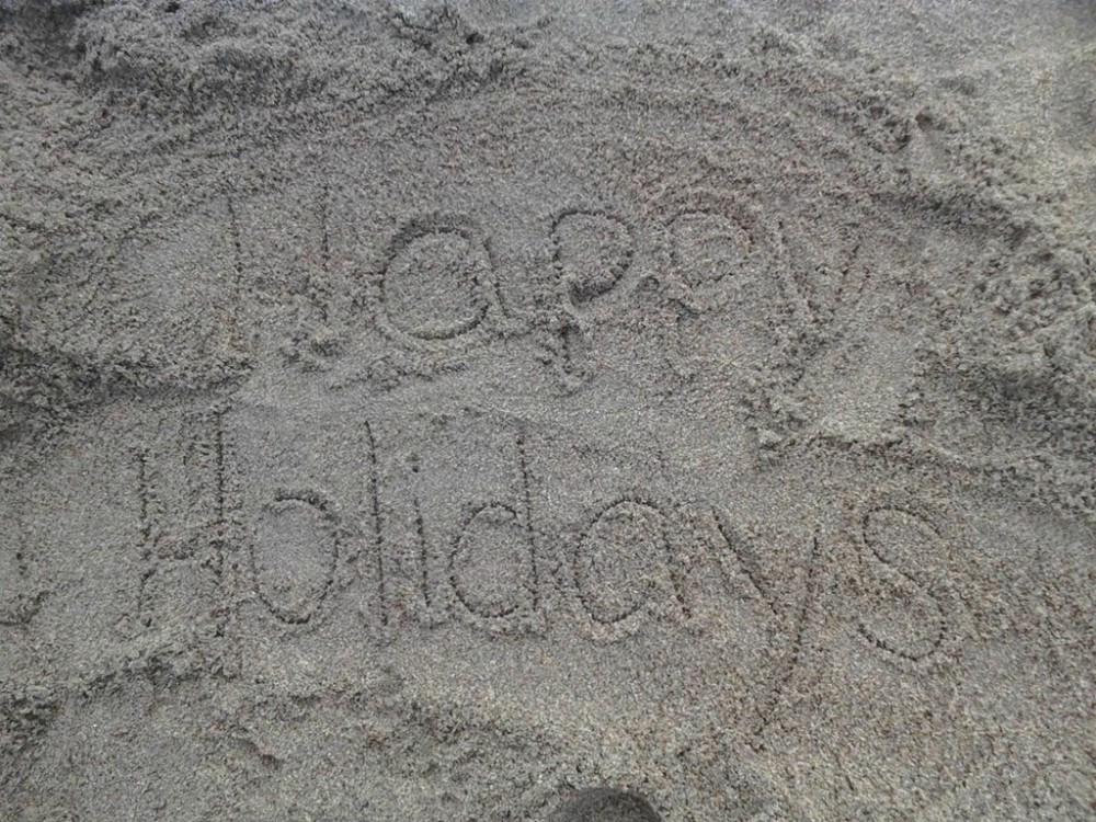 image of a message written on sand