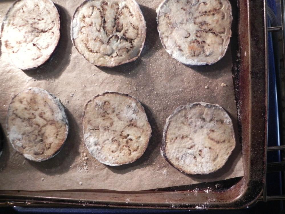 overhead image of sliced eggplant on baking tray