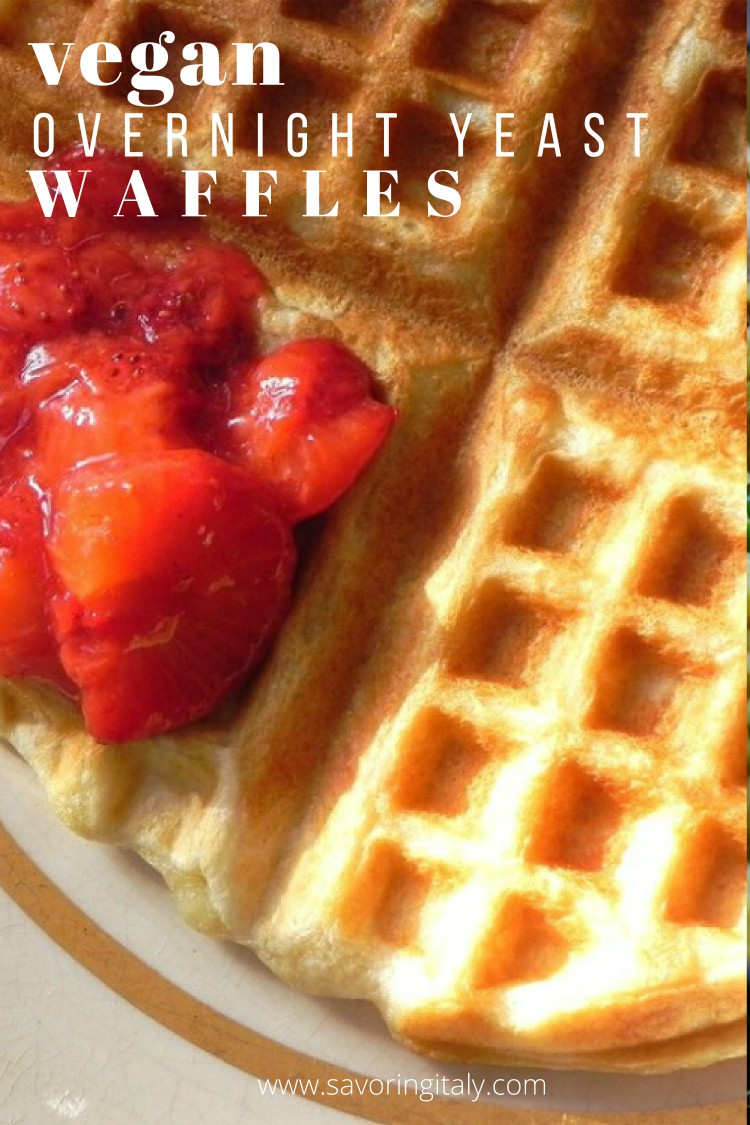 overhead image of strawberries on top of a yeast waffle