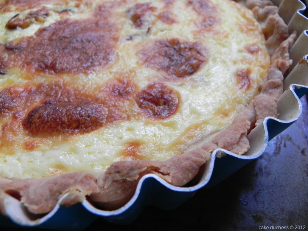 overhead image of quiche in a pan