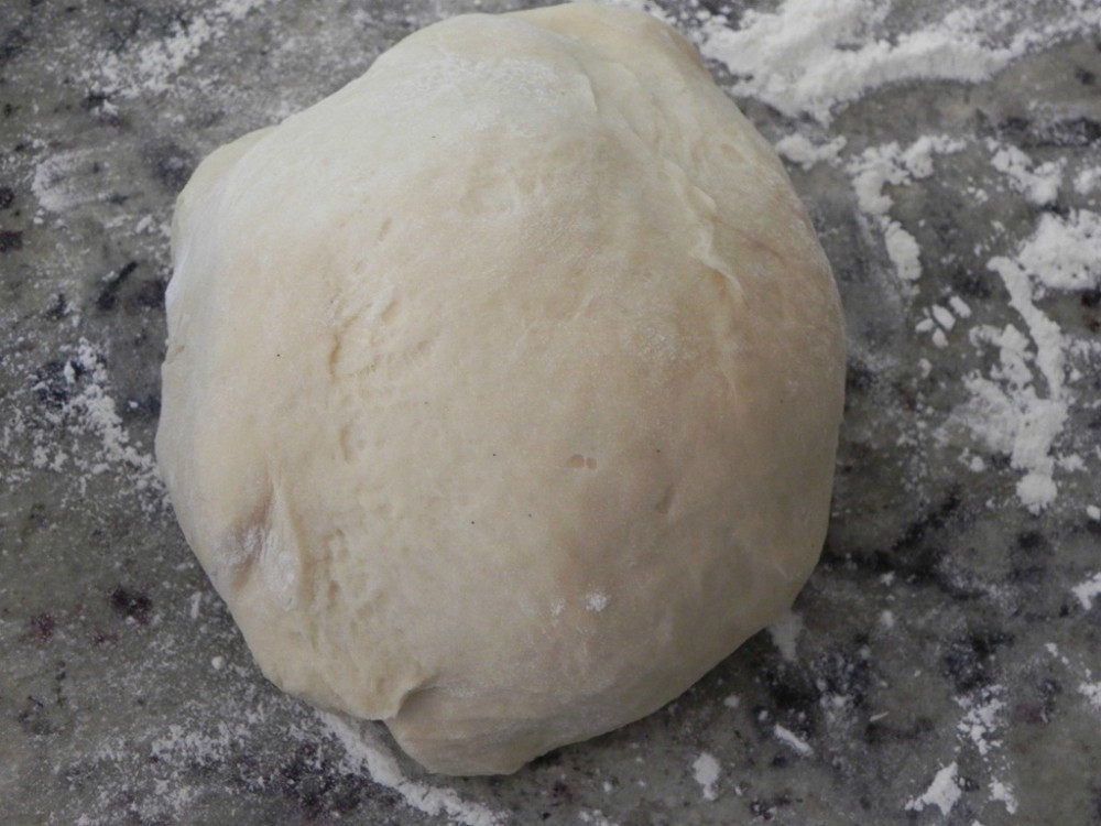 overhead image of dough on marble