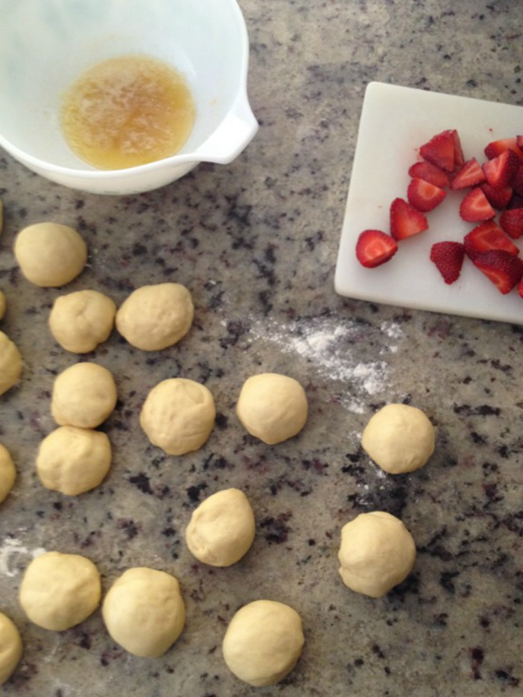 overhead image of making dough balls and strawberries