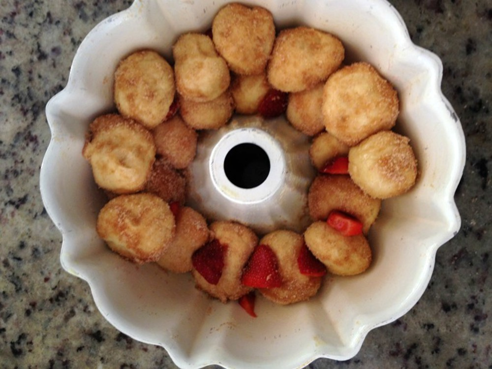 overhead image of dough balls in bundt pan