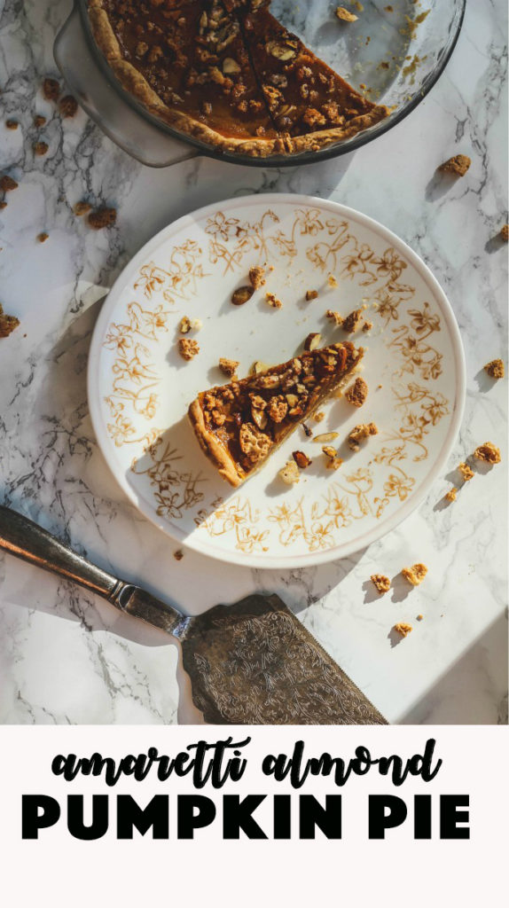 overhead shot of slice of pumpkin pie with amaretti cookie topping