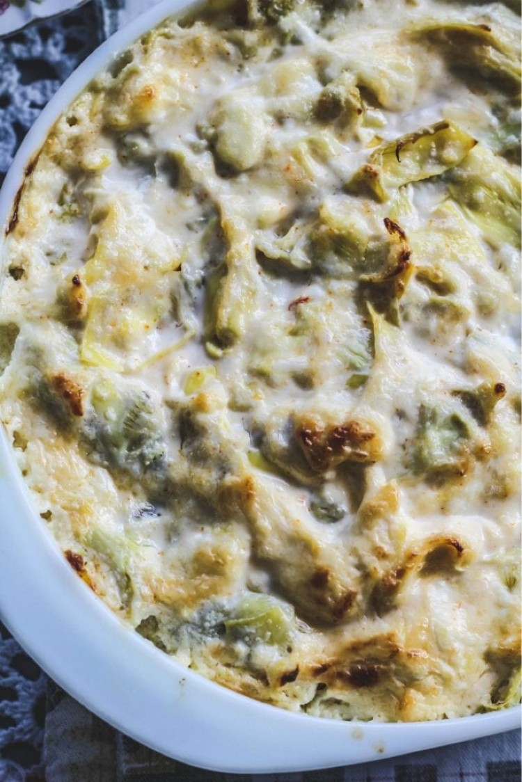overhead image of hot and cheesy artichoke dip