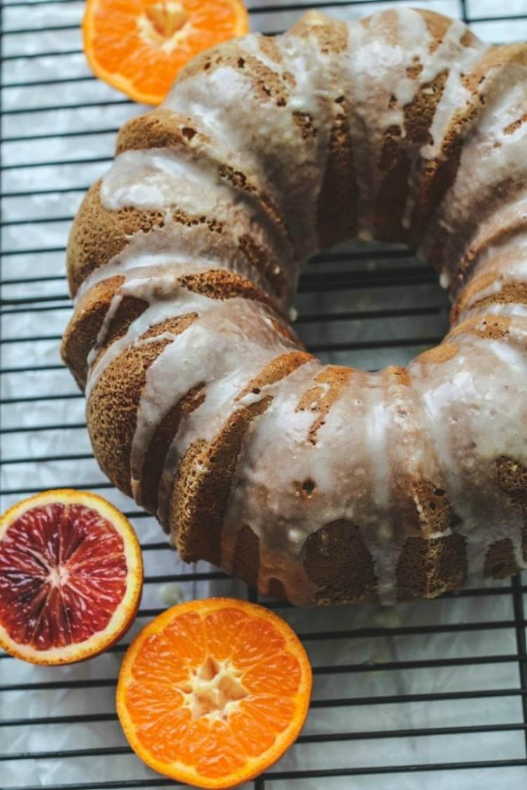 overhead image of bundt cake with oranges