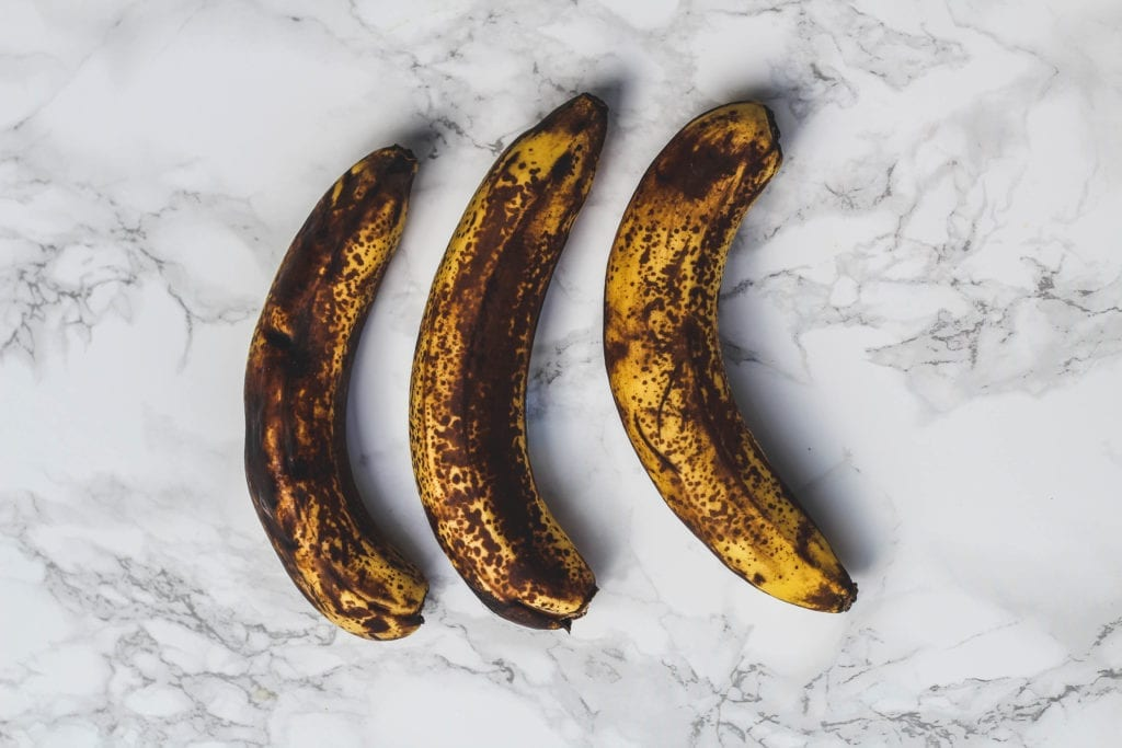overhead image of bananas on marble background