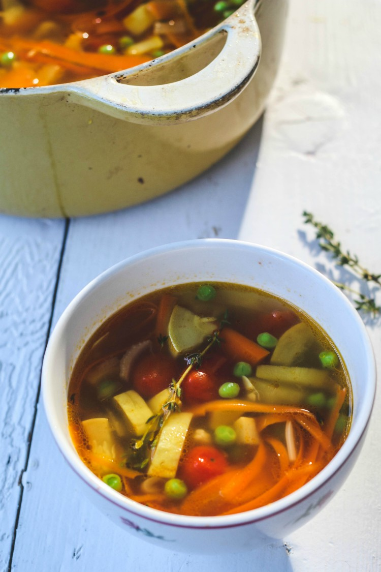 overhead image of summer minestrone in white bowl