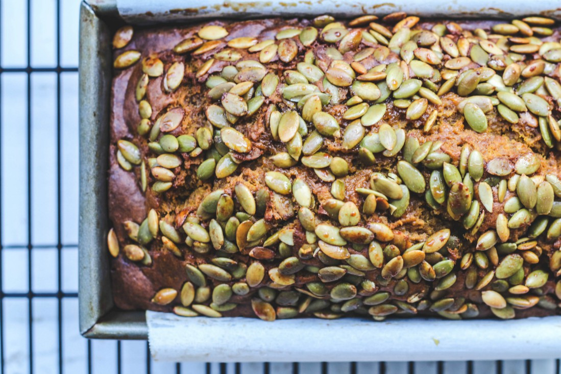 loaf of bread with pumpkin seeds on top
