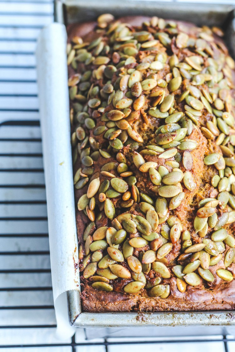 overhead shot of loaf of bread with pumpkin seeds