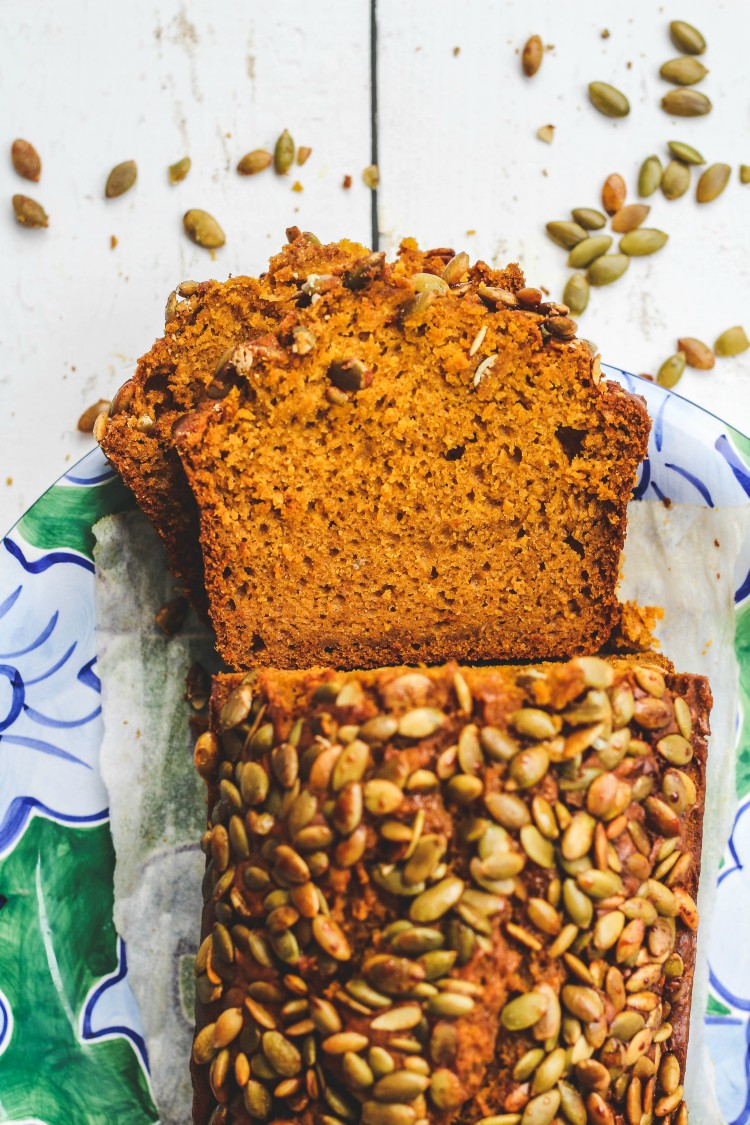 loaf of bread with pumpkin seeds sliced