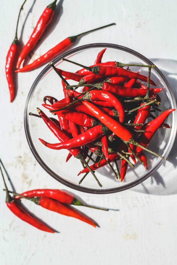 overhead image of Thai chili peppers in glass bowl