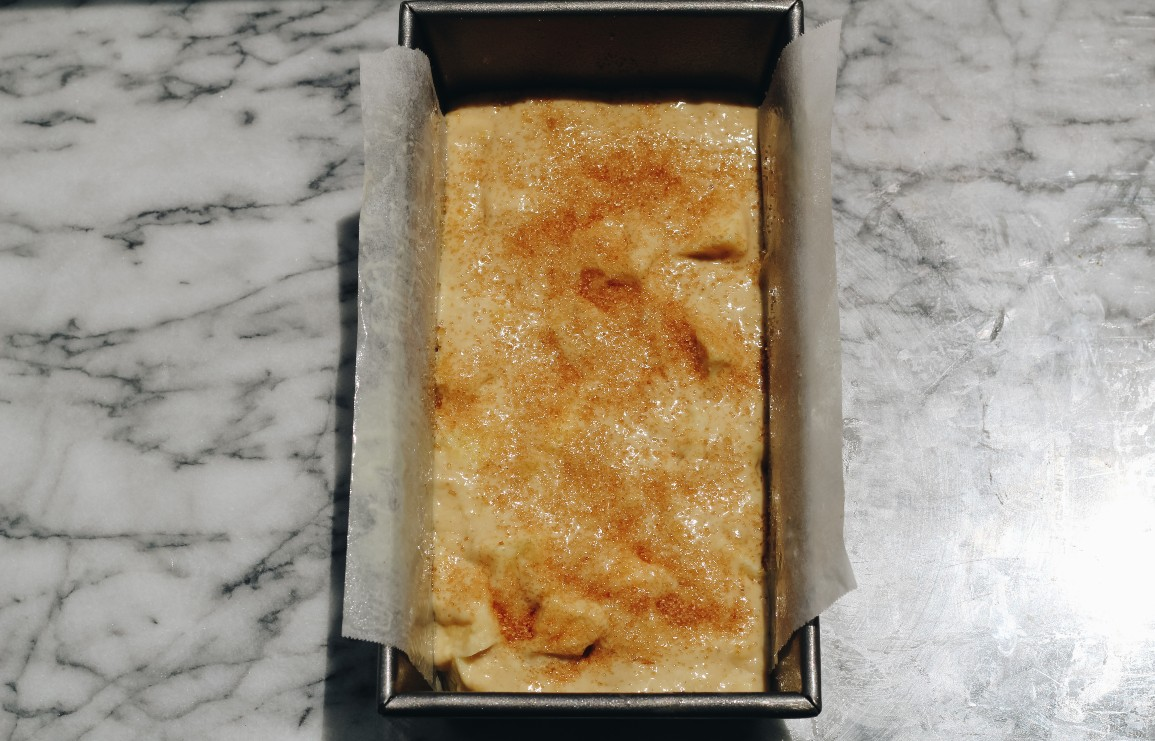 overhead image of banana bread in a baking pan