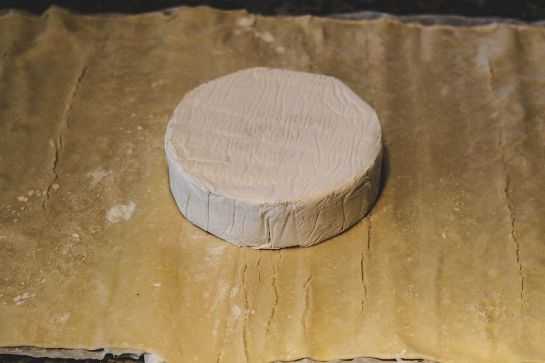 overhead image of brie on pastry sheet