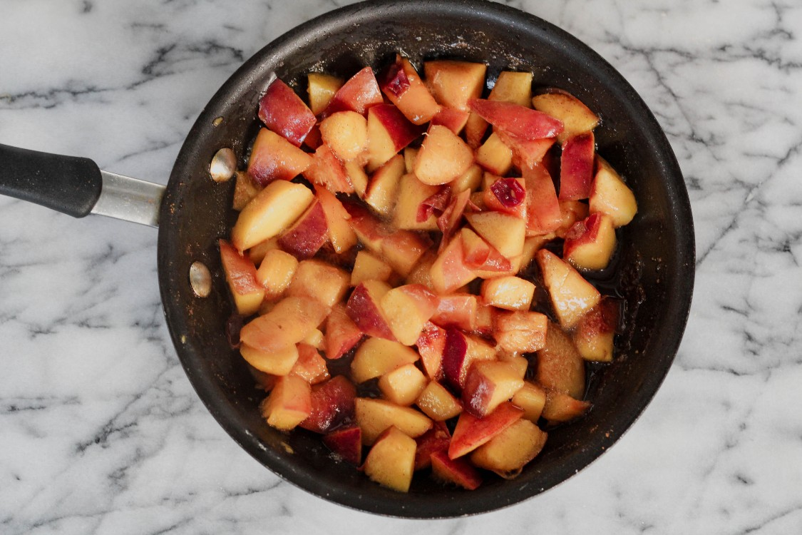 image of peaches in a small skillet