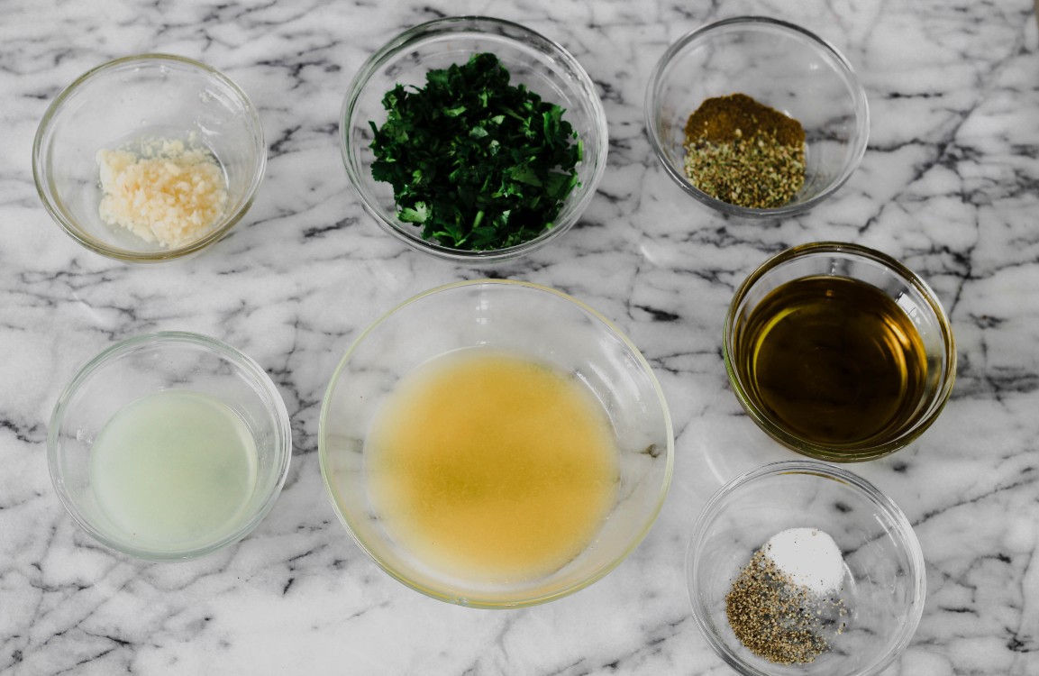 overhead image of mojo marinade ingredients on marble counter