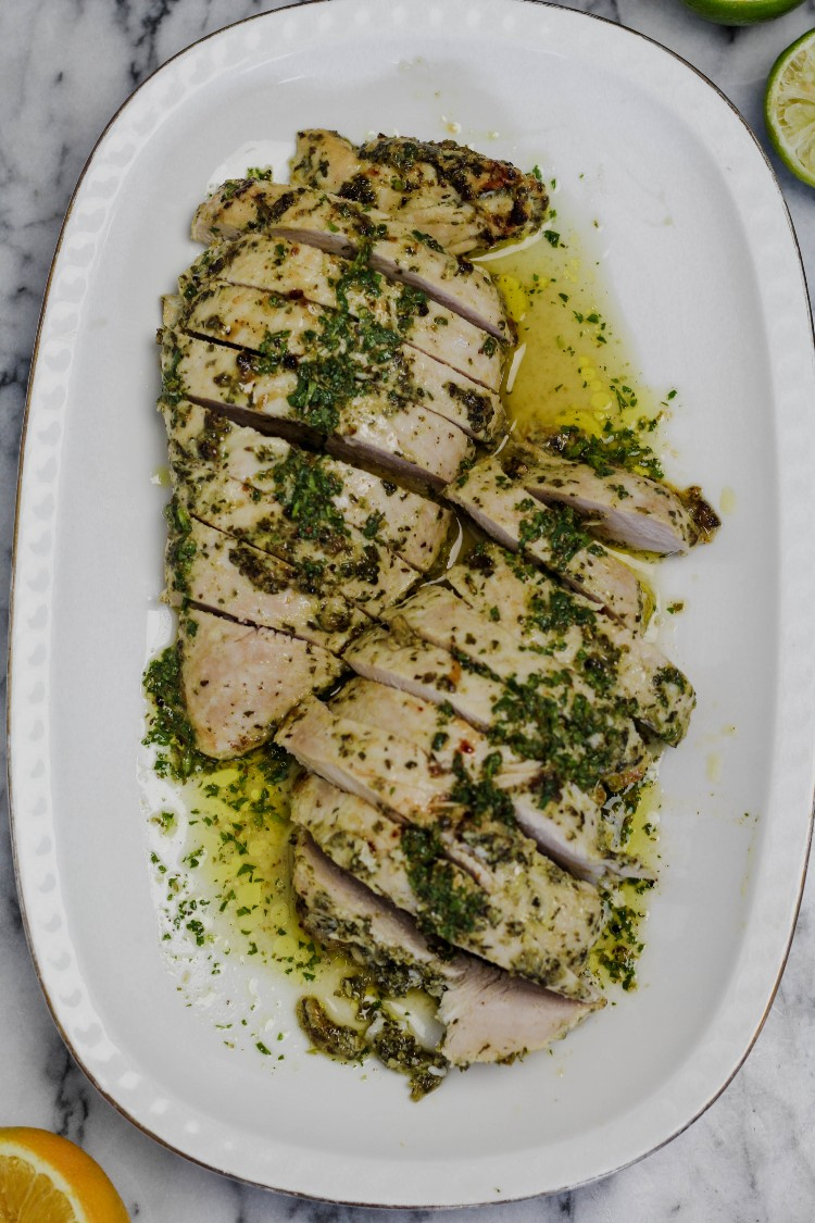 overhead image of mojo turkey tenderloin on white plate