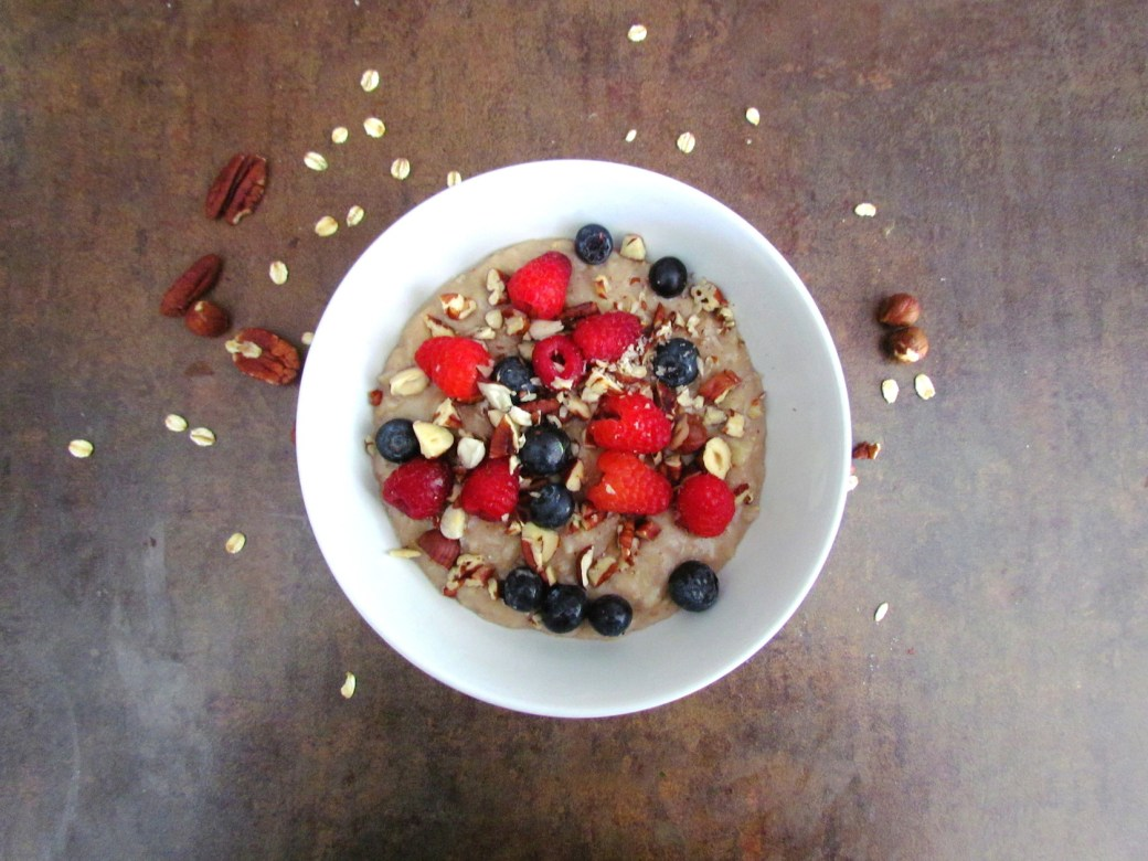 coconut oatmeal topped with berries and nuts