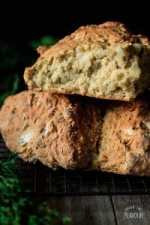 irish soda bread on a wire cooling rack with greenery