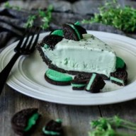 No Bake Frozen Grasshopper Pie: a super easy recipe made with an Oreo crust and creamy mint filling. This St. Patrick's Day mint treat is sure to become a family favorite! | www.savortheflavour.com #stpatricksday #oreo #mint #nobake #frozendessert