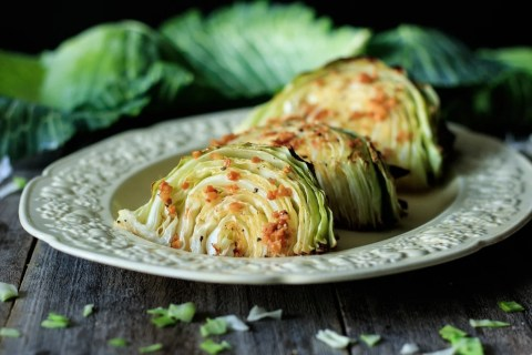 Roasted Cabbage Wedges with Lemon Garlic Butter: an easy, healthy side dish that you can serve with a low carb dinner. Simply use fresh green cabbage, garlic, lemon, and butter. Enjoy the health benefits of this quick vegetarian recipe that can be roasted in the oven on one tray. | www.savortheflavour.com #cabbage #irish #stpatricksdayfood #vegetarian #lowcarb
