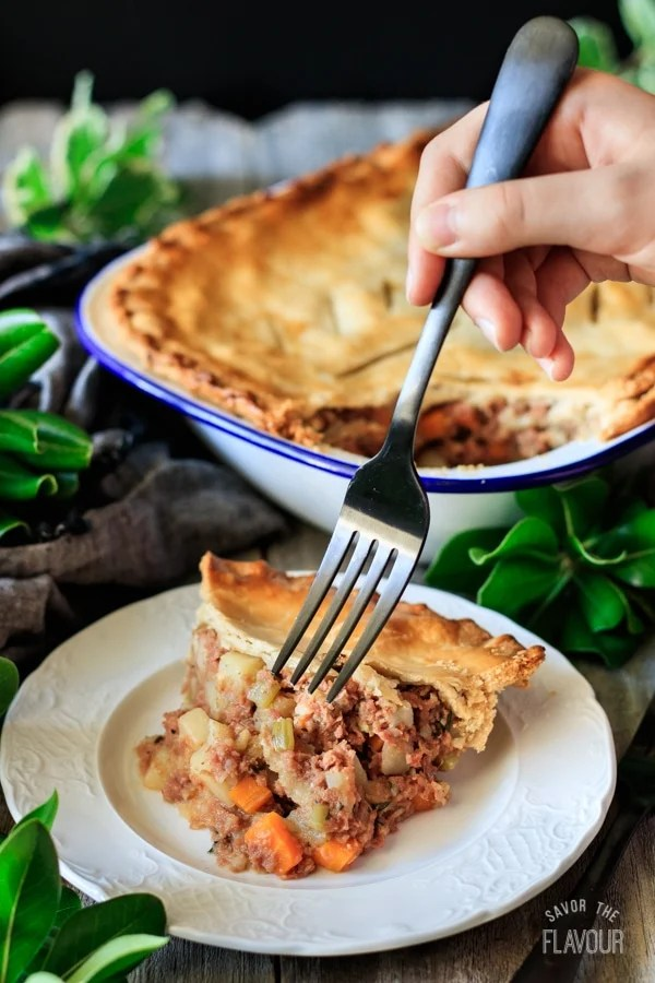 plate of corned beef pie with fork