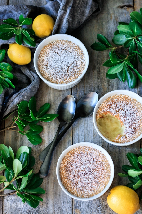 three lemon pudding cakes with two spoons