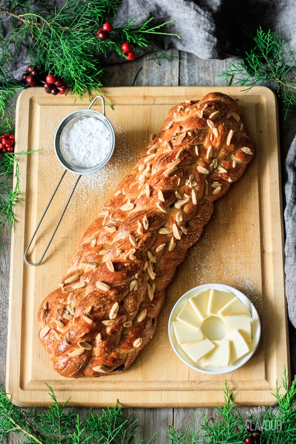 a baked loaf of vánočka on a wooden cutting board