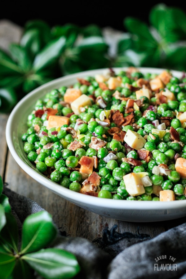 bowl of pea salad with bacon