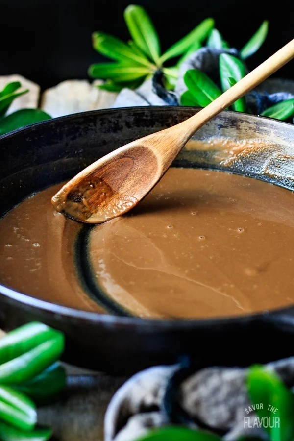 stirring roux in a cast iron skillet