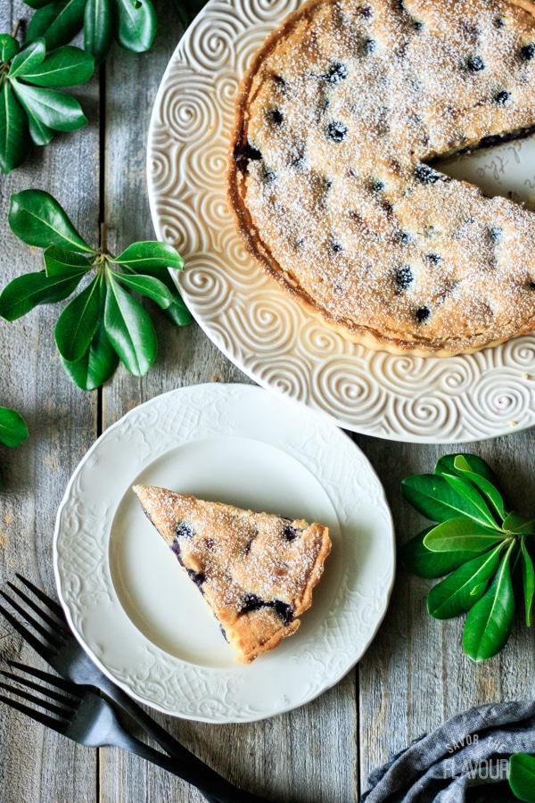 slice of blueberry frangipane tart on a plate