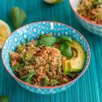 Quinoa Salad with Tomato and Avocado - A tasty combination of wholesome ingredients makes this dish a favorite on hot summer days.