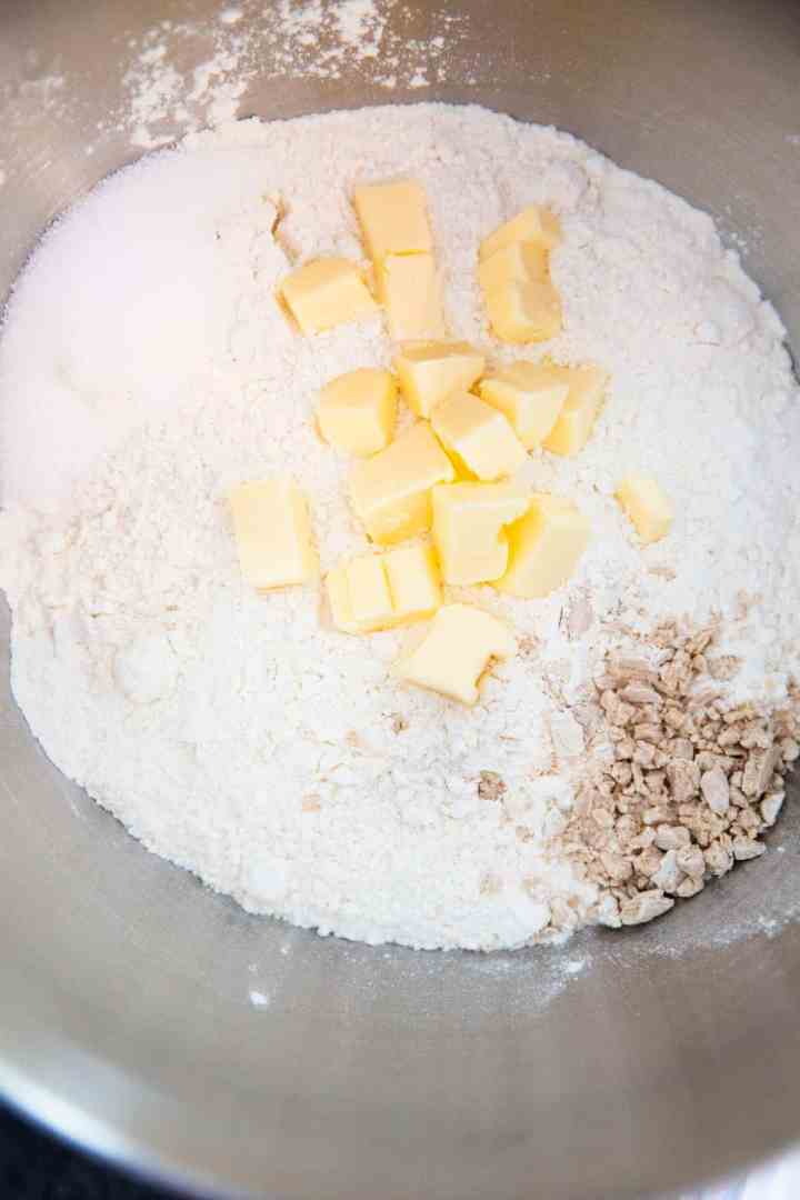 top down view of bowl with flour, yeast and butter