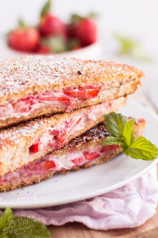 stack of strawberry cream cheese stuffed French toast on a plate