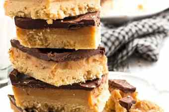 A stack of no bake millionaire's shortbread bars