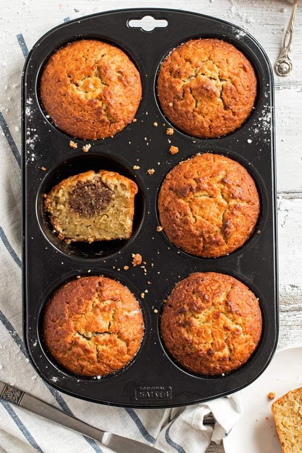 muffin pan with stuffed apple muffns