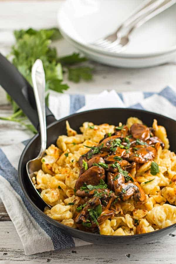 black skillet with authentic German spaetzle and mushroom gravy