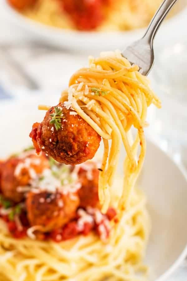 fork with spaghetti and a turkey meatball