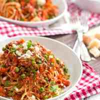 This Slow Cooker Sausage Pasta Sauce is an easy way to get a homemade dinner on the table with little hands-on time! Tastes best topped with lots of Parmesan!