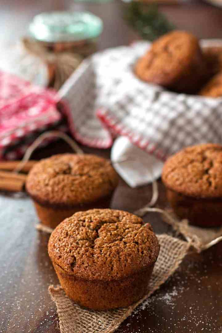 gingerbread muffins scattered on a wooden surface