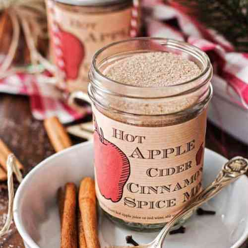 jar with apple cider spice mix on a Christmas decorated table