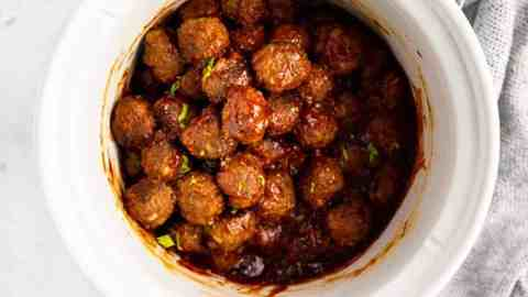 white slow cooker with bbq meatballs