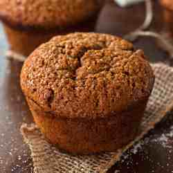 close up photo of single gingerbread muffin on a piece of jute