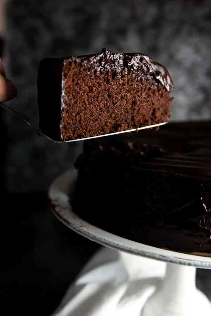 slice of chocolate honey cake on cake lifter