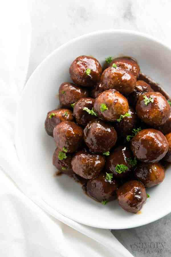 With just 5 ingredients and only 5 minutes prep time, this easy Cranberry Glazed Turkey Slow Cooker Meatballs recipe is a real crowd pleaser at holiday parties and for football game day snacking. It uses 100% juice and honey for a healthier glaze. | savorynothings.com