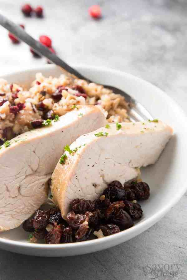 This slow cooker turkey breast with cranberry apple wild rice is a simple fall dinner that only requires 5 minutes prep time! You could even serve it to a small family on Thanksgiving! | savorynothings.com