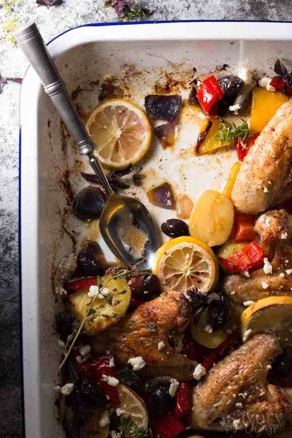 This One Sheet Pan Greek Style Easy Baked Chicken Dinner will save you at dinner time! You can throw everything onto your sheet pan and let it bake into a delicious dinner. The sauce that forms is so good!